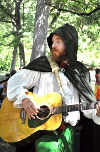 RA Alum Harper Stone with Guitar